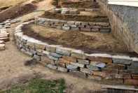 Stone retaining walls and planters